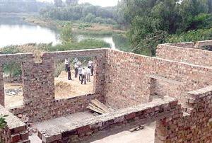 郑州西流湖湿地现违建房 官方:已确认权属将拆除