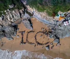 千人净滩  温岭市举办2018第六届温岭海洋生态文明暨国际海滩清洁日活动